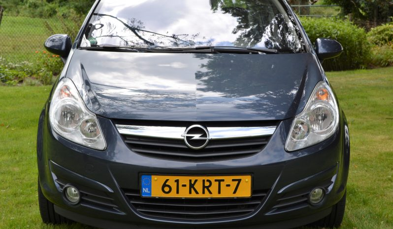 """Opel Corsa 1.4 16V Cosmo   5 drs   Climate   Cruise   PDC   Half Leder   16"""" LM. full"""